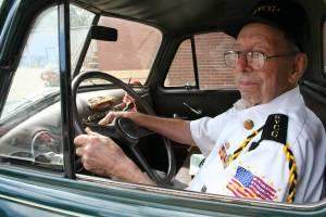 Proud World War II veteran Howard Homeier in his early 1950s vintage Chevrolet pickup truck.