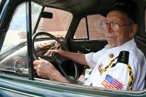 Proud World War II veteran Howard Homeier in his early 1950s vintage Chevrolet pickup truck.