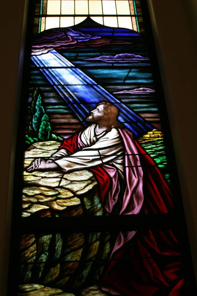 Another window shows Jesus praying in the Garden of Gethsemane.