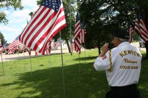 Donald Meese snaps a photo of the flag flown in honor of his son-in-law, Lt. Col. Kevin Duffy of the U.S. Army.