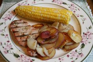 The perfect summer meal: baby potatoes and sweet corn from the Faribault Farmers' Market and a grilled pork chop