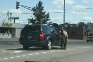 A Faribault firefighter seeks donations while standing in the traffic lane of busy N.W. Fourth Street.