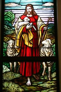 The Good Shepherd stained glass window at the front of the church.