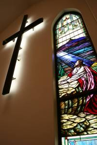 This stained glass window is among many from the old church building incorporated into Immanuel Lutheran's new house of worship.