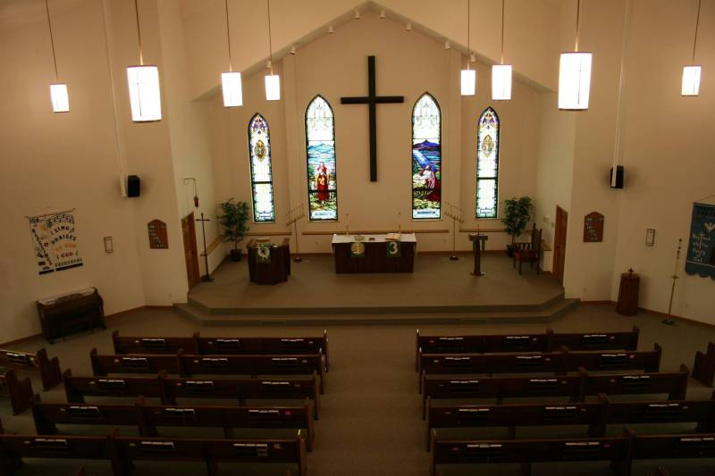 A view of Immanuel from the church balcony. The pews, the chancel furnishings and the stained glass windows from the old church were incorporated into the new church.