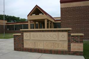 """Yes, they do know how to spell at my alma mater in Wabasso. The sign marking the current building came from the old building. And apparently back in the day, a """"u"""" looked like a """"v."""""""