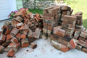 Two brick piles, one for fill, the other to recycle, are accumulating on our driveway. Anyone want brick?