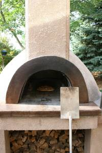 The pizzas are baked for several minutes in this 700-degree brick oven.