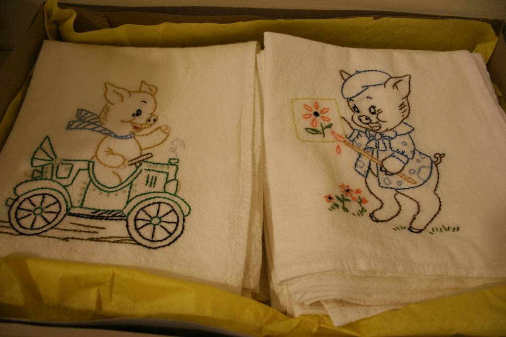 Embroidered dish towels were among silent auction offerings.
