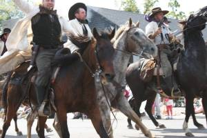 I shot this image of the James-Younger gang riding their horses along the parade route. Because my shutter speed wasn't set fast enough for the action, the photo is a bit blurry. But I like it that way.