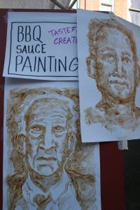 Jeff Pridie of Faribault painted with BBQ sauce, a painting event offered at the kids' booth.