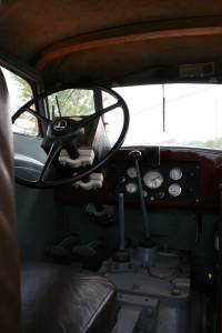 Inside the cab of the rare Minneapolis Moline UDLX, a comfort tractor that even included a radio, that box behind the steering wheel.