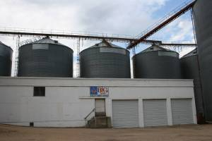 I like this photo because of how the three grain bins mimic the three doors on this building at the Nicollet Farmers Exchange Company.