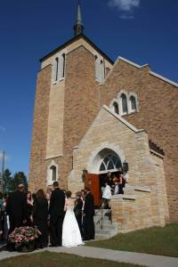 Newly-weds Kristina and Corey greet well wishers outside St. Elizabeth's Church in Brennyville.