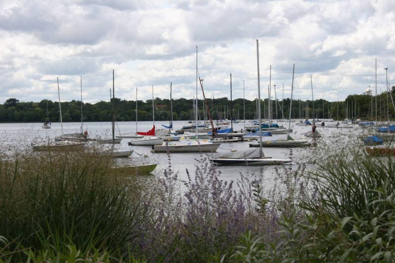 Sailboats sit upon the waters of Lake Harriet.