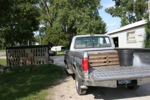 The Twiehoffs' pickup truck sits outside their produce-filled pole shed.
