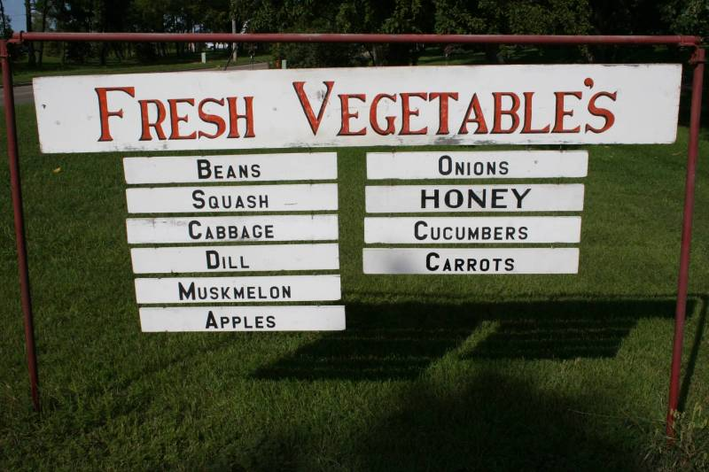 A homemade sign indicates the produce available.