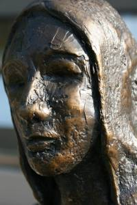 """I moved in close for this image of the haunting face of """"Woman at the Well"""" by Daphna Russell on the corner of 3rd St. N.W. and Minnesota Ave. N.W. For sale for $4,600."""