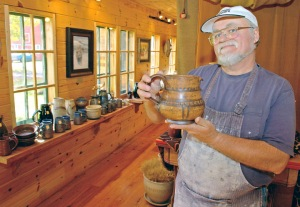 Gene Tokheim displays a piece of stoneware. Photo courtesy of Minnesota Office of Tourism.