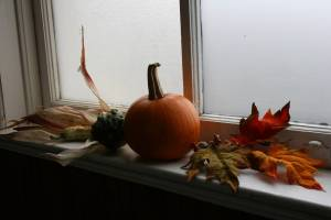 Autumn decorations from a wedding adorn the church window sills.