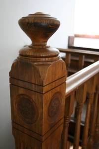 Stairway banister in the balcony.