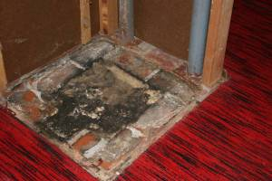 Finally, we reached the bottom of the chimney in the basement. And, yes, the red carpet has to go too.