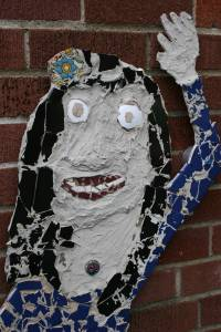 A face of Mexico depicted in a mosaic on the side of the school building.