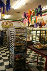 Stacks of pastries and bright colors greet customers inside the bakery.