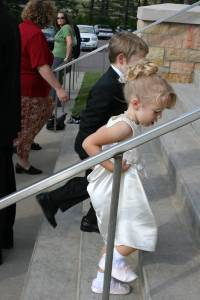Keira and her brother, Tristan, who was a ring bearer, run up the steps of St. Elizabeth's Church in Brennyville.