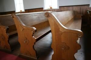 Original pews inside the 1894 church.