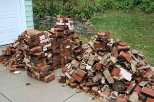 My son and I carried all of these bricks out of our house after my husband dismantled an old chimney.