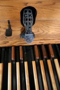 How many feet have touched the pedals of the old pipe organ?