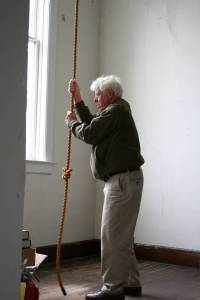 Ringing the church bell.