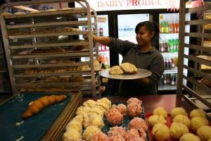 Selecting treats at Mariano Perez' bakery.