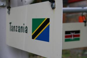Tanzania is represented by a giraffe, butterfly and elephant.