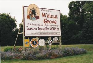 A sign welcomes visitors to the childhood home of author Laura Ingalls Wilder in Walnut Grove.