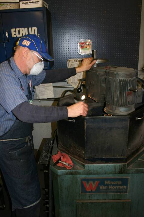 Randy grinds a flywheel.
