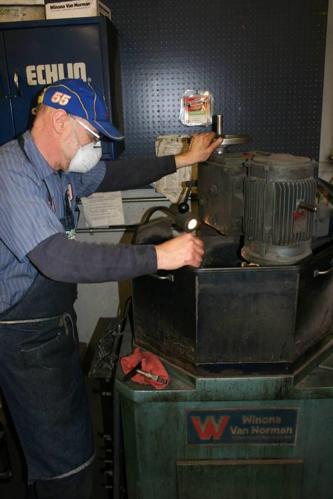 Randy grinds a flywheel.
