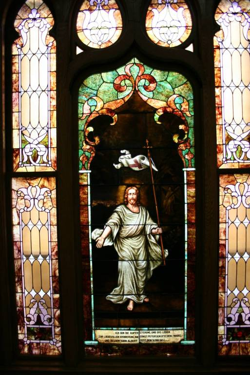 """I am the resurrection and the life."" A stained glass window in the Trinity Lutheran Church sanctuary, Faribault, Minnesota."