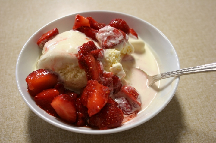 The Moland folks serve a generous amount of strawberries with two scoops of ice cream.