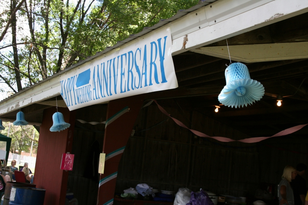 With the help of enthusiastic preteens, we decorated the park shelter and a screened tent with bells and crepe paper in honor of Jeff and Janet's 20th wedding anniversary.
