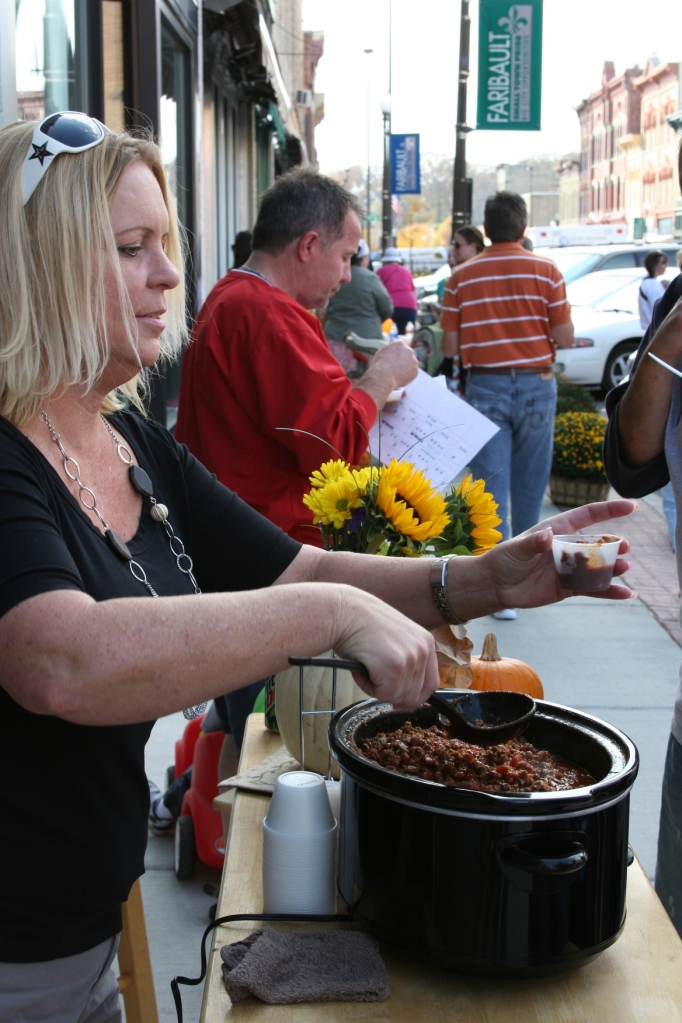 """Christine Henke serves chili, which I classified as """"very spicy"""" at Glam Central Salon."""