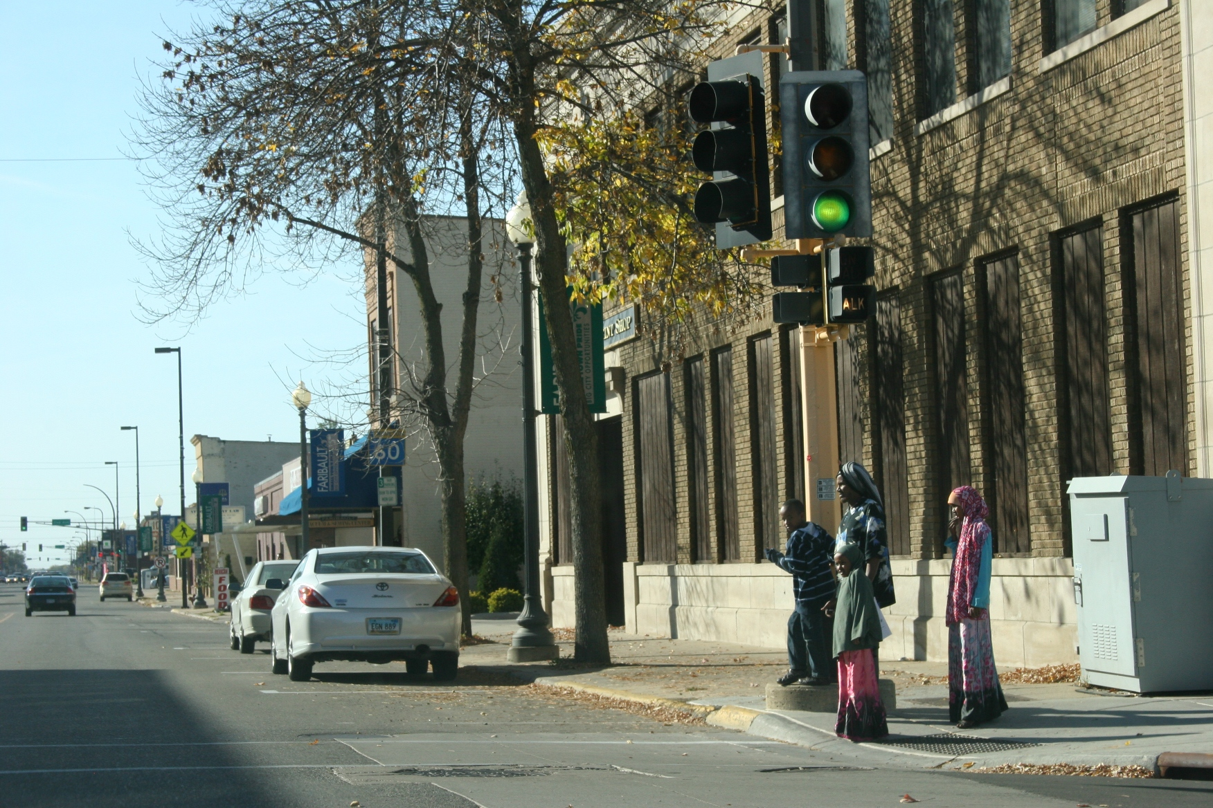 In this file photo, a Somali family waits to cross a downtown Faribault street.