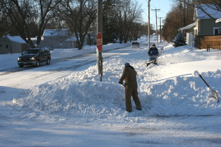 My husband shovels the end of the sidewalk while our neighbor works toward him with the snowblower. What a great neighbor.