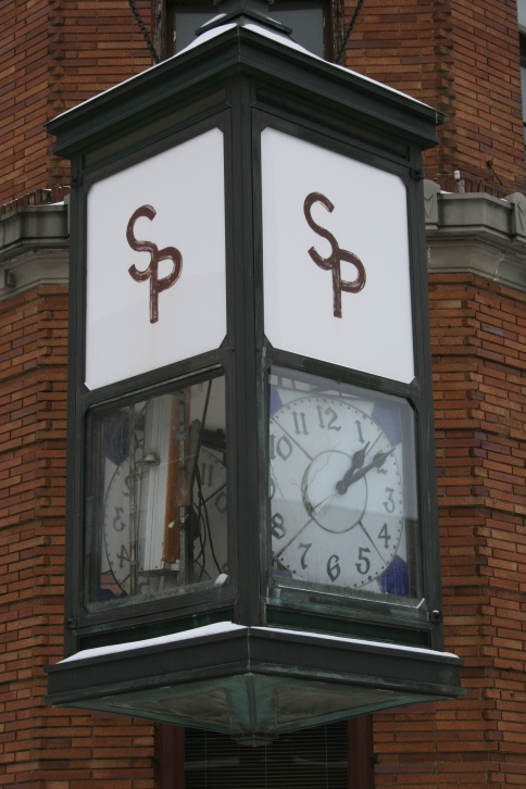 The clock that graces the corner of the Security Bank building has fallen apart.
