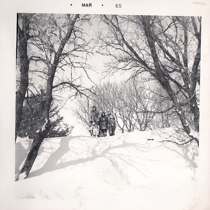 This huge, hard-as-rock snowdrift blocked our farm driveway in this March 1965 photo. I think my uncle drove over from a neighboring farm to help open the drive so the milk truck to reach the milkhouse.