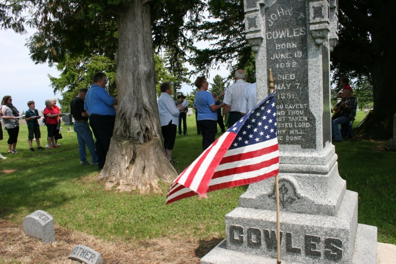 About 30 people gather at the Cannon City Cemetery for an afternoon Memorial Day observance.