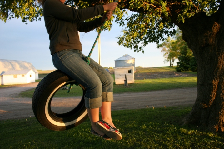 In this June 2011 photo, my daughter swings on a tire swing on my childhood farm.