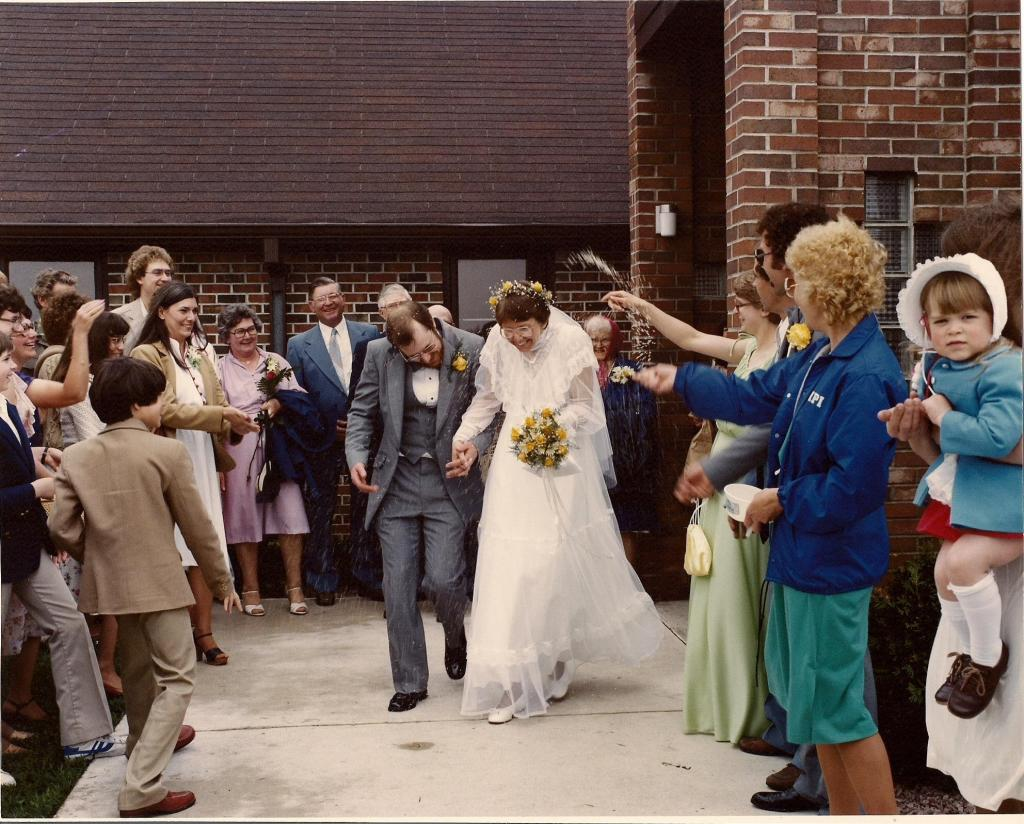 Wedding guests toss rice at Randy and me as we exit St. John's Lutheran Church following our May 15, 1982, wedding.