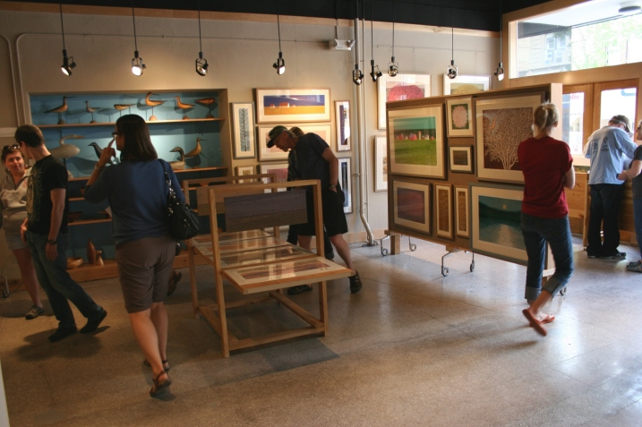 Visitors to the Kaddatz Galleries in downtown Fergus Falls peruse the art of Charles Beck.